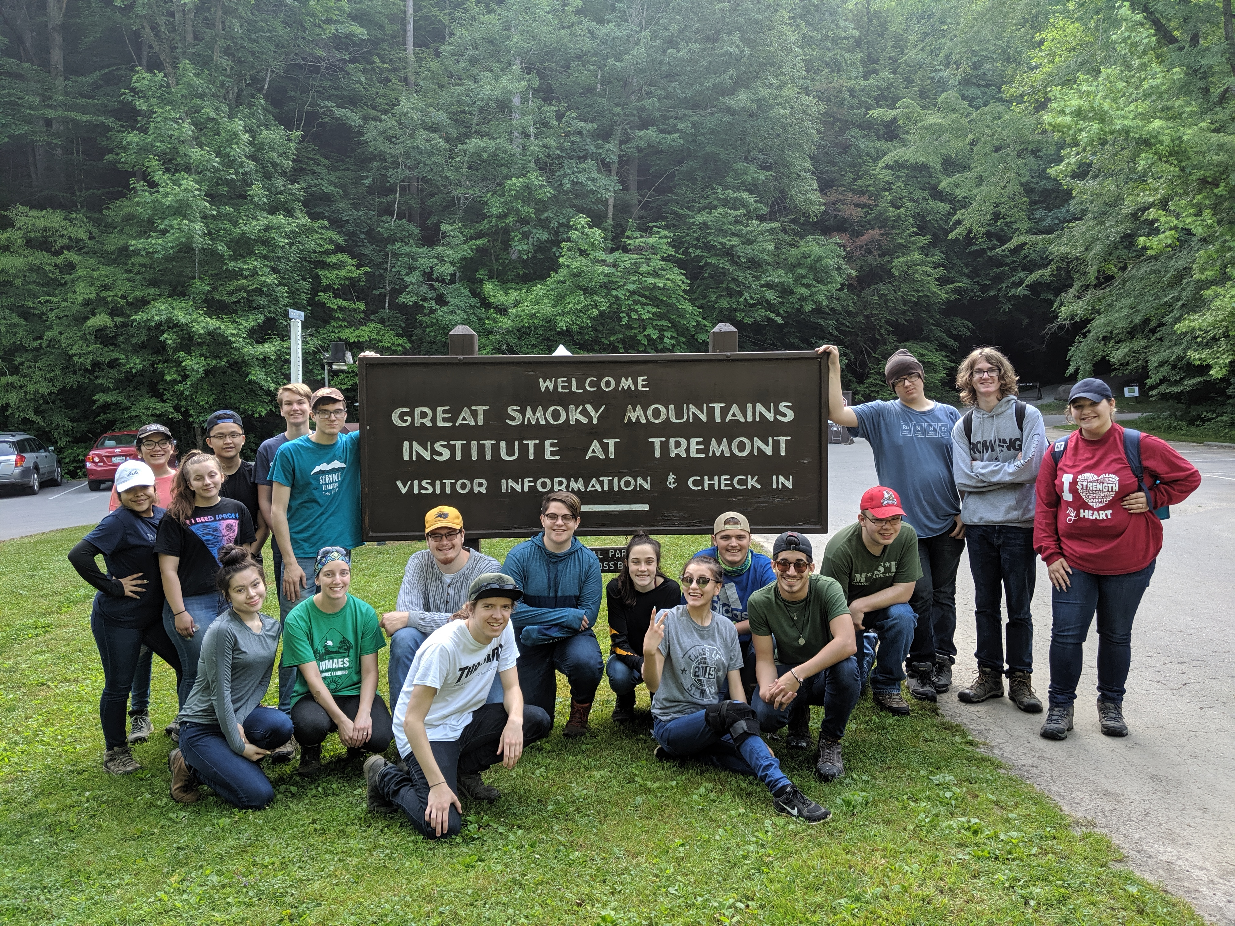 West Michigan Academy of Environmental Science students sit in front of the Great Smoky Mountain sign